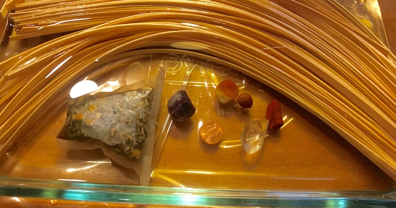 Glass Casserole Dish with Reeds soaking in herb tea water with stones