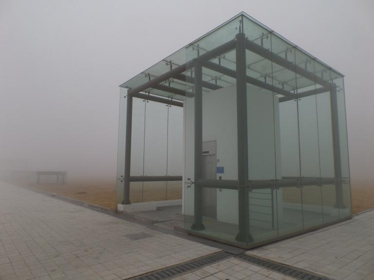 Glass Elevator in the Fog