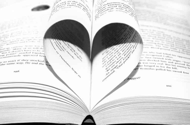 Book with pages folded in a heart
