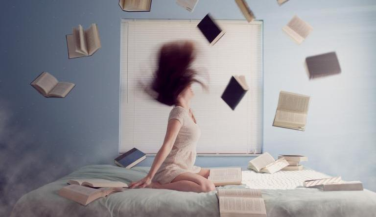 Frustrated woman surrounded by falling books