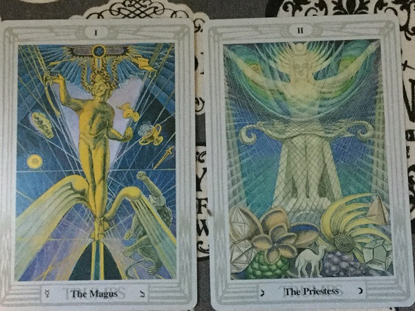 """The Magus and The Priestess from Aleister Crowley's Thoth Deck, inspired by """"The Book of Thoth"""" Painting by Lady Frieda Harris. Photo by Coby Michael"""