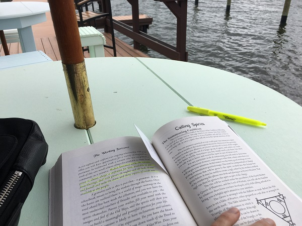 Doing some reading at The Getaway on the pier.  Courtesy of author.