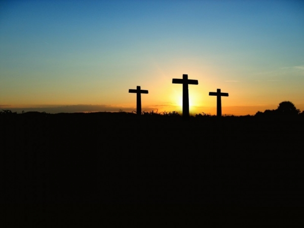 silhouette-of-crosses-on-hill-at-sunset