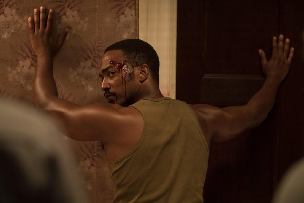 Detroit movie scene hands against wall