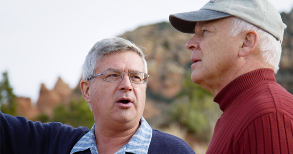 Host Del Tackett discusses scientific research with Dr. Andrew Snelling in the creationist documentary Is Genesis History? Image courtesy of Compass Cinema