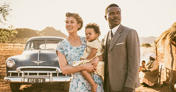 "Rosamund Pike as ""Ruth Williams,"" Madison Manowe as ""Baby Jaqueline,"" and David Oyelowo as ""Seretse Khama"" in the film A United Kingdom. Photo by Stanislav Honzik. © 2016 Twentieth Century Fox Film Corporation All Rights Reserved"