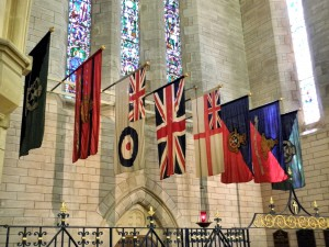 Row of flags hanging inside the Anglican Cathedral of the Most Holy Trinity, Hamilton, Bermuda, 2014 - by ΙΣΧΣΝΙΚΑ-888 (Flags_-_Anglican_Cathedral_of_the_Most_Holy_Trinity_-_Hamilton_Bermuda_2014..jpg) (CC BY-SA 3.0 [https://creativecommons.org/licenses/by-sa/3.0/deed.en]), via Wikimedia Commons