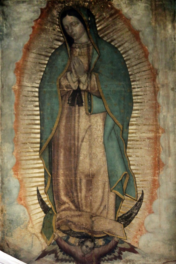 Original Picture of Our Lady of Guadalupe (also known as the Virgin of Guadalupe) shown in the Basilica of Our Lady of Guadalupe in México City. The Catholic Church considers the image of the Virgin of Guadalupe imprinted on the cloak of Juan Diego as a picture of supernatural origin. (PD-Art), via Wikimedia Commons