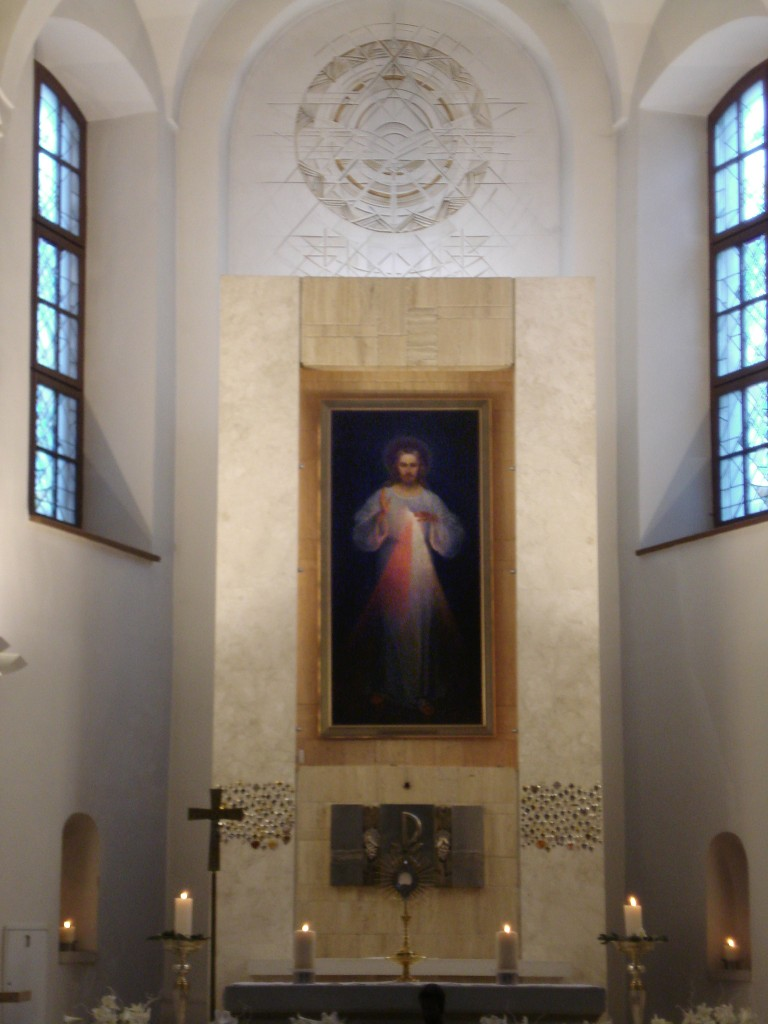 "Original Divine Mercy Image (with inscription ""Jezu ufam Tobie"") in the Divine Mercy Sanctuary in Vilnius (Dievo Gailestingumo šventovė). Dominikonų g. 12 - by Alma Pater (Divine_Mercy_Sanctuary_in_Vilnius4.jpg) [CC BY-SA 3.0 (https://creativecommons.org/licenses/by-sa/3.0/deed.en)], via Wikimedia Commons"