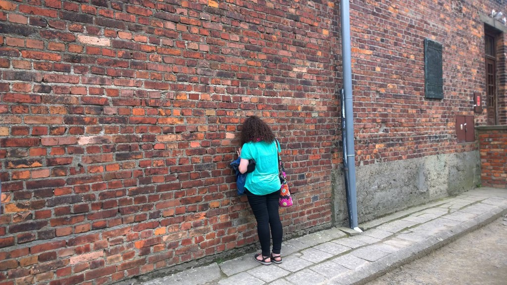 Eugenia praying outside the cell where Fr. Kolbe died (credit: Lawrence Lam)
