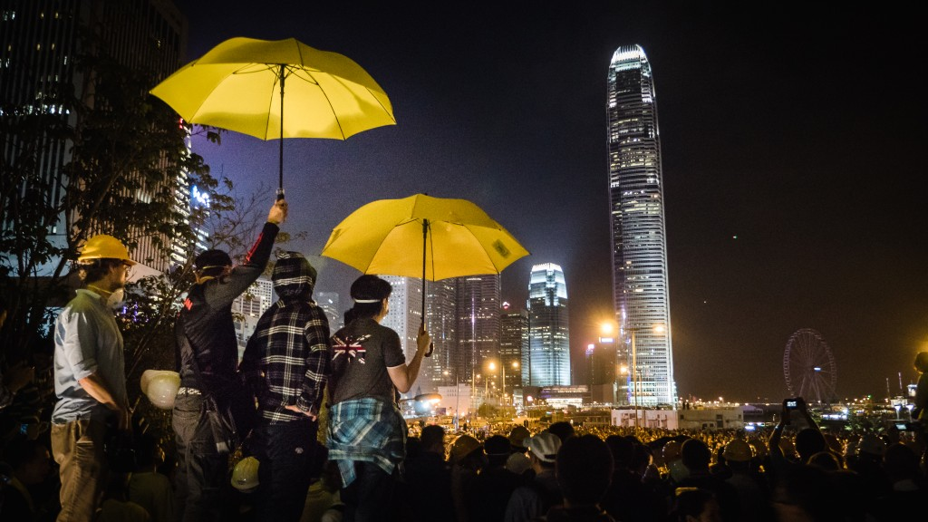 "umbrellarevolution #occupycentral #occupyhk #occupyhongkong news.yahoo.com/katie-couric-now-i-get-it-umbrella-revolut... ""By Katie Brinn The scene in Hong Kong over the past week has gone from chaos to calm and back again, as tensions grow and pro-democracy throngs clash with pro-China demonstrators. It all started on Sept. 26, when hundreds of students gathered in a courtyard in Central Hong Kong, demanding an end to Chinese oppression and control. China's modern history with Hong Kong has been complicated, to say the least. For more than 150 years, Hong Kong belonged to Britain. Then in 1997 Britain handed the thriving metropolis back to China in a political deal called ""One Country, Two Systems,"" which allowed Hong Kong to maintain some of the freedoms and independence mainland Chinese people do not have, such as freedom of the press and the right to assemble. The people of Hong Kong would even be allowed to elect their own leader in 2017. But this summer China started to backpedal. It announced to Hong Kong that those elections could proceed only if the Chinese government selected all the candidates. To the people of Hong Kong, that meant they wouldn't have much control over their own government after all. The students hit the streets, and thousands from Hong Kong rushed to join them in the days that followed. The Chinese government and the protesters have dug in their heels, and negotiations have failed. Now counter-protests from pro-China residents are complicating the situation. To understand how the protests have escalated to this point, check out the video above, so as we watch the conflict develop, you can say, ""Now I Get It."""" - by Pasu Au Yeung, 30 November 2014 (Hong_Kong_Umbrella_Revolution_-umbrellarevolution_-UmbrellaMovement_(15292823874).jpg) (CC BY 2.0 [https://creativecommons.org/licenses/by/2.0/deed.en]), via Wikimedia Commons"