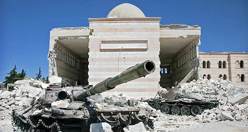 a destroyed building with a tank out front