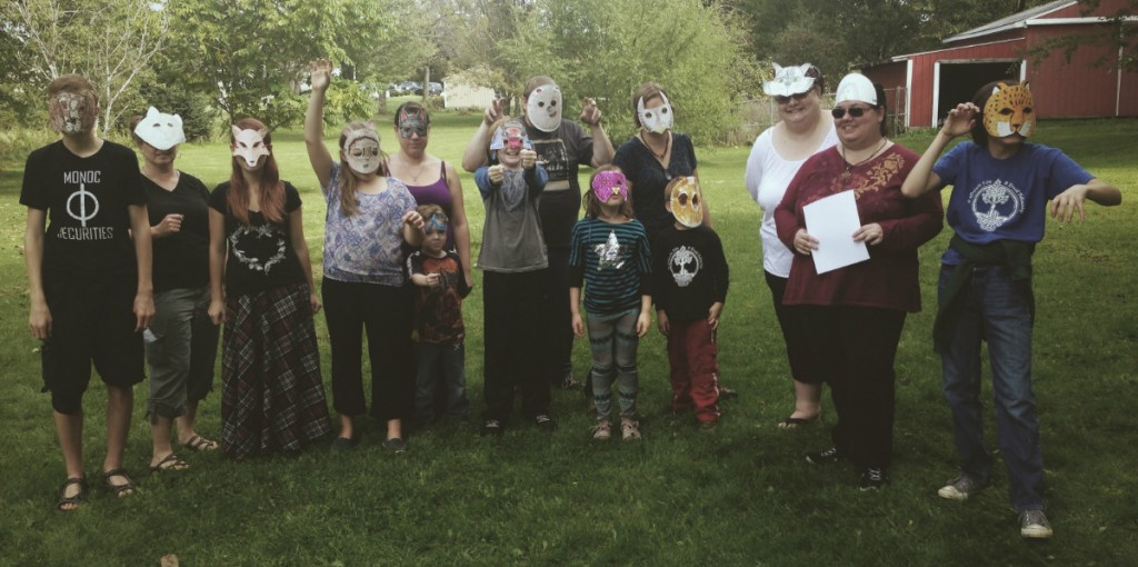 Druids celebrating Mabon wearing animal masks