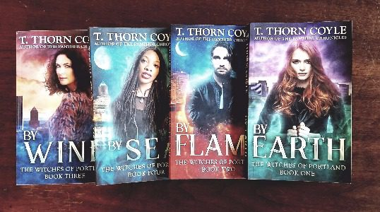 The four books that this humble Blogger currently owns in the Witches of Portland series