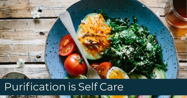 Purification is Self Care with a healthy looking artfully arranged plate of greens, tomatoes, hard boiled eggs, and avocado.