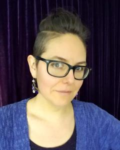 Headshot of Melissa Hill, spiritworker and priestess of the earth.