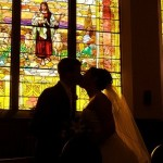 Couple at marriage kissing in front of stained glass - photo by D'Arcy Norman.jpg - square