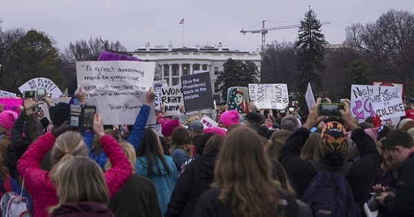 Women showing their own resistance outside the White House on January 21, 2017 (photo Tyler Merbler)