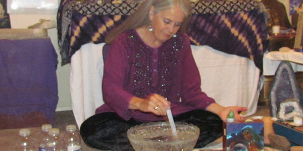Kathryn Ravenwood sitting at the Sacred Water Altar - Used with Permission