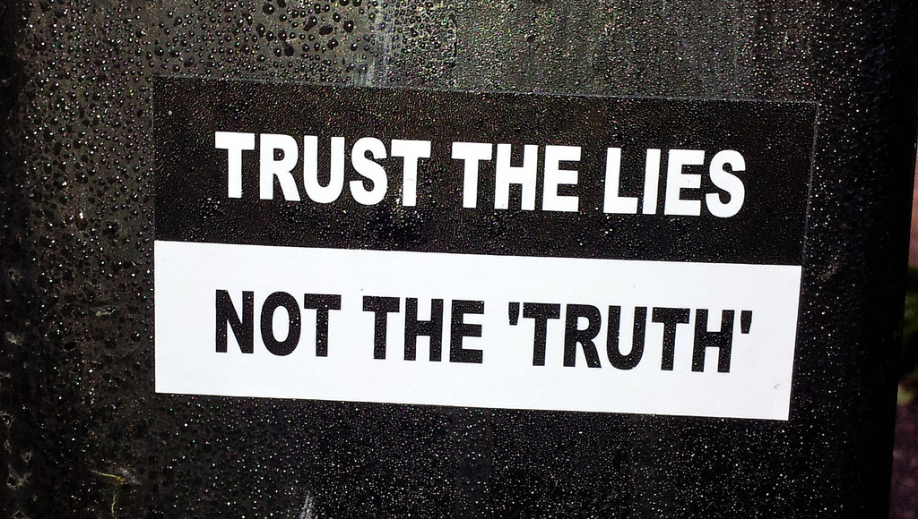 """photo saying """"trust the lies, not the 'truth'"""" (Thomas Guest/Flickr)"""