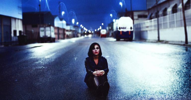 Woman on Dark Road