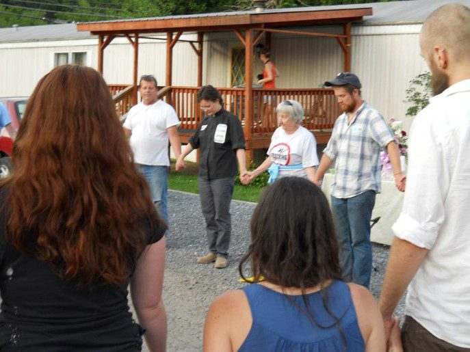 Leah Schade leading a prayer vigil held at the site of Riverdale Mobile Home Park in Jersey Shore, PA, before it was destroyed to make room for a water withdrawal plant along the Susquehanna River for the fracking industry. May 2012.