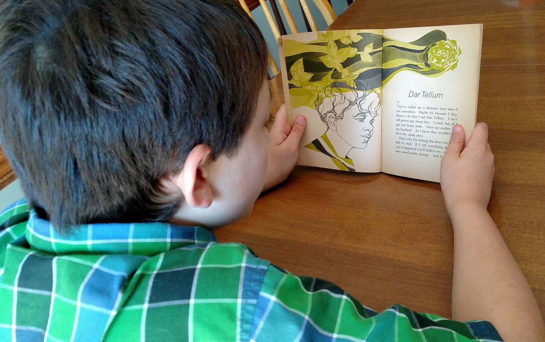 My son reading Dar Tellum. Photo credit: Leah D. Schade