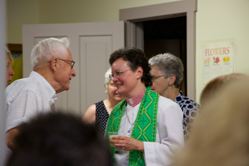 The Rev. Dr. Leah Schade with parishioners. Photo by Dan Hyde. Used with permission.