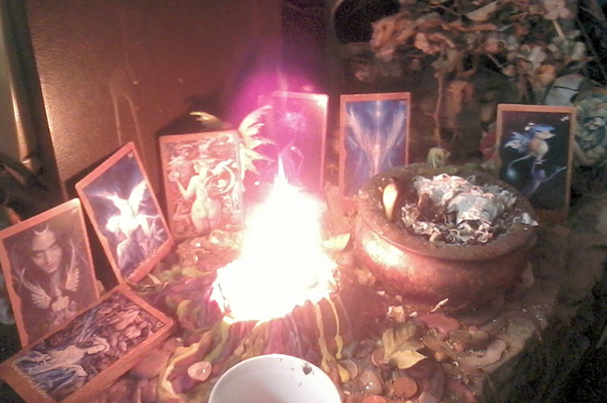 Community fairy altar with oracle cards and offering candle [Morgan Daimler]