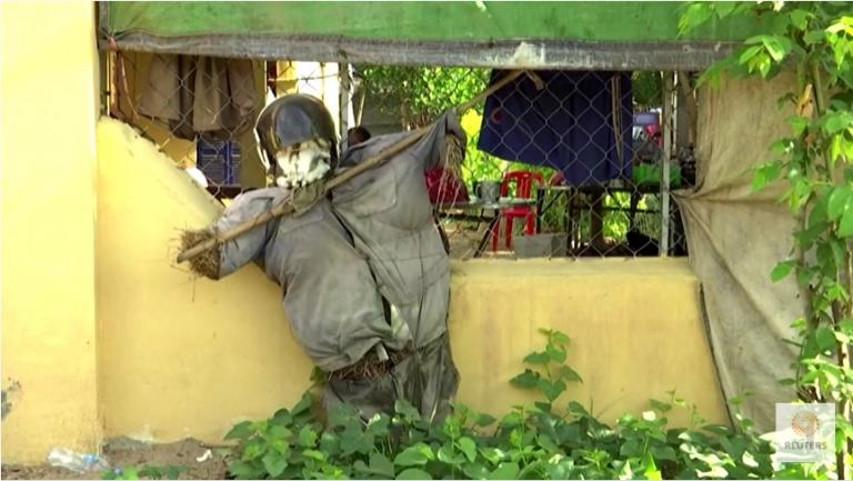 """""""Cambodian uses scarecrows to 'ward off' COVID"""" - Reuters"""