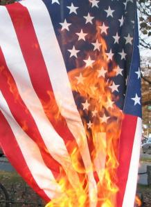 "I don't like flag burning. But Trump metaphorically ""burns"" the flag every day with his actions. Obtained through Creative Commons."