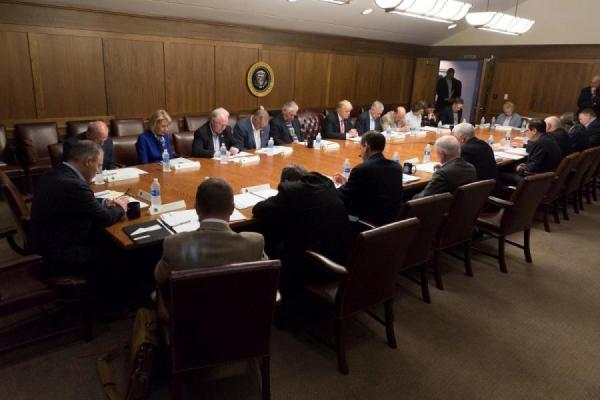"Trump and his Cabinet ""pray"" at Camp David. Obtained through Creative Commons."
