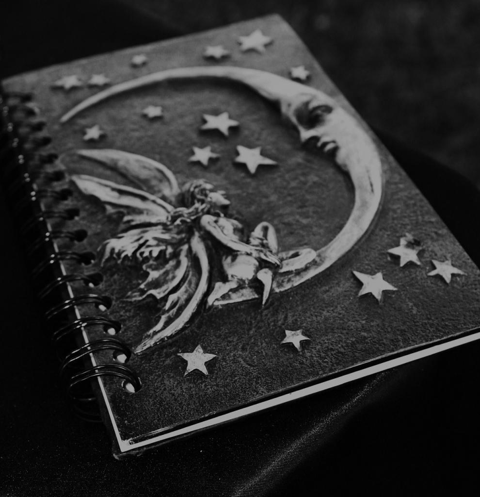book of shadows with a faery and a moon