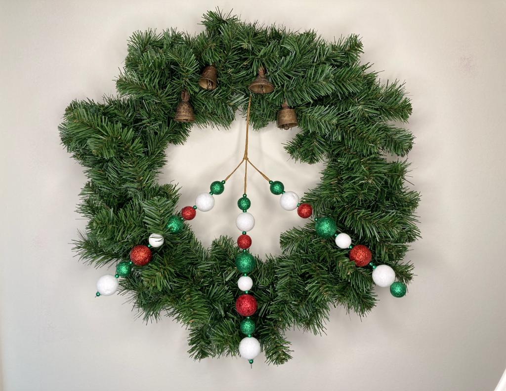 christmas yule solstice peace wreath with evergreen peace sign and bells