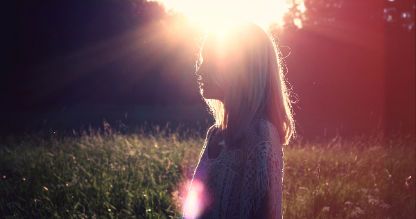 Woman feels blessing by the sun