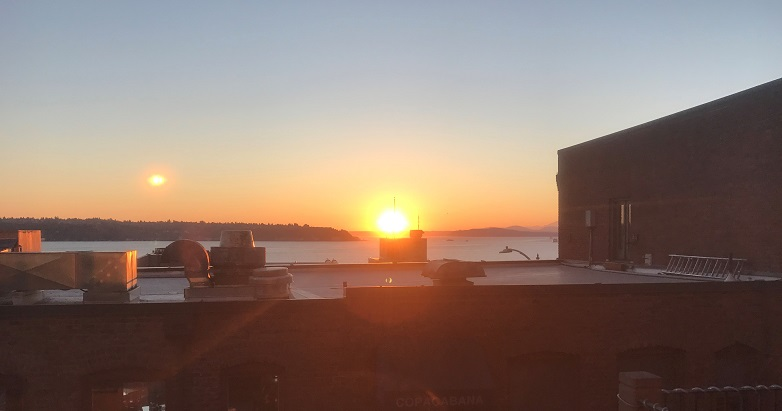Sunset over the Salish Sea, seen from Pike Place Market, Seattle, WA, USA.