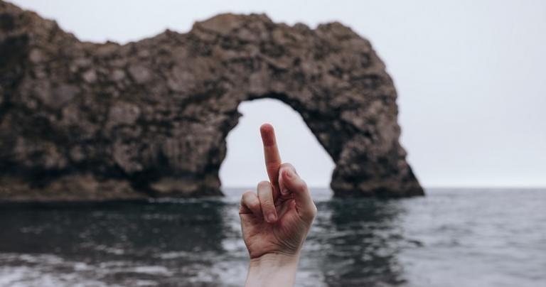 critique, durdle door, middle finger