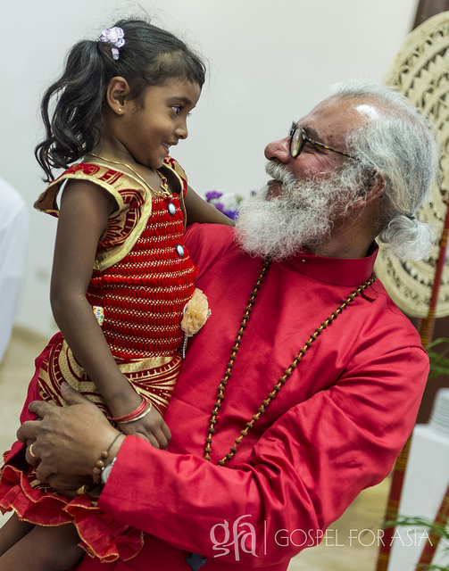 KP Yohannan Holds a Child