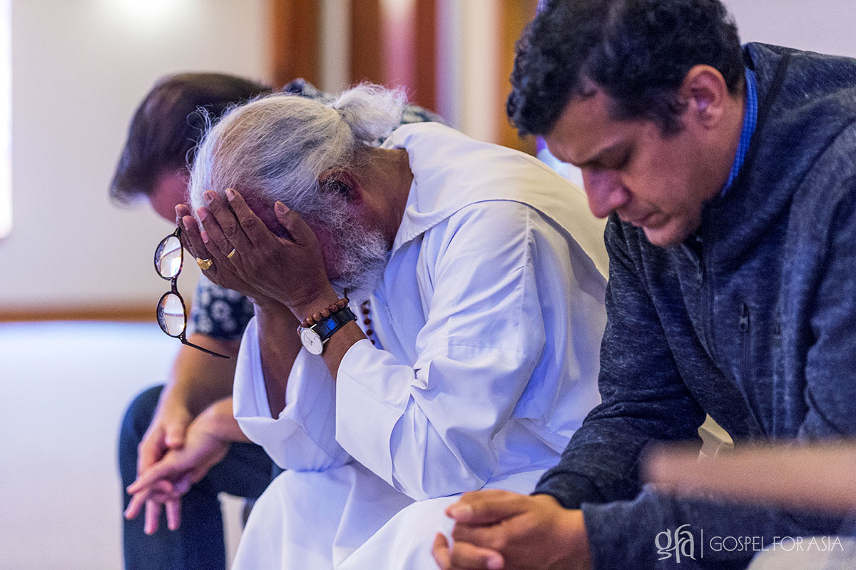 Brother K.P. Yohannan is praying after he shared powerful and challenging message with the staff during a staff meeting in the Chapel on September 27, 2017.