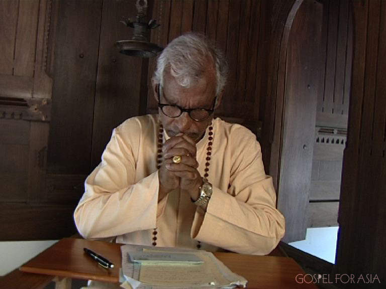 Dr. KP Yohannan Metropolitan in prayer in Kerala, India.