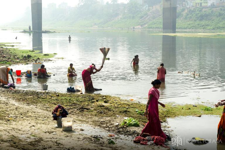 Washing their clothes in this dirty river - KP Yohannan - Gospel for Asia