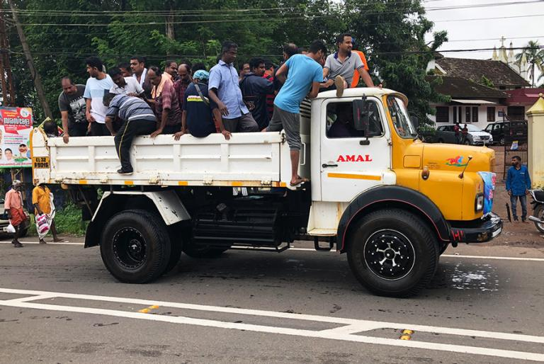 A truck dropping people off at a relief camp in Kerala - KP Yohannan - Gospel for Asia