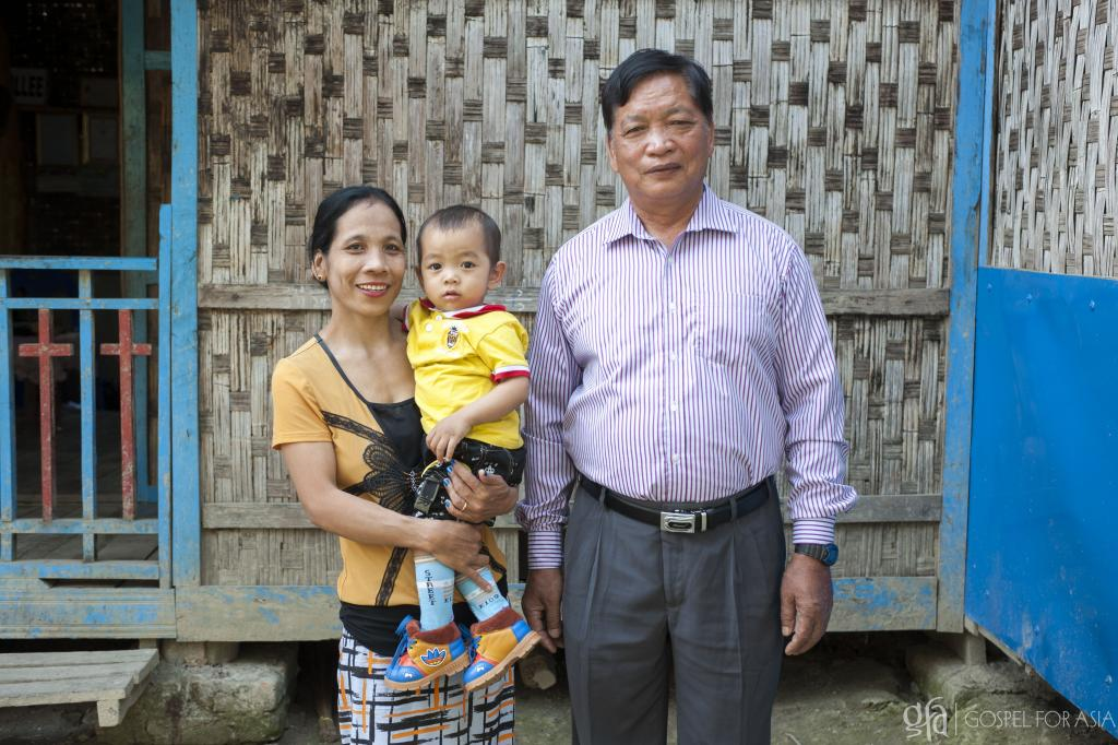 Gospel for Asia-supported pastor Myo Zaw with his wife and youngest son.