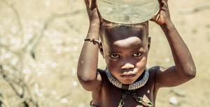 a child carries water in kunene namibia - KP Yohannan - Gospel for Asia