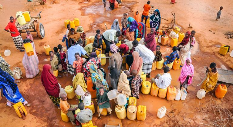 Refugees wait for water in a camp in Dadaab, Somalia - KP Yohannan - Gospel for Asia