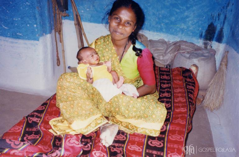 A young Indian woman happily poses with her newborn baby - KP Yohannan - Gospel for Asia