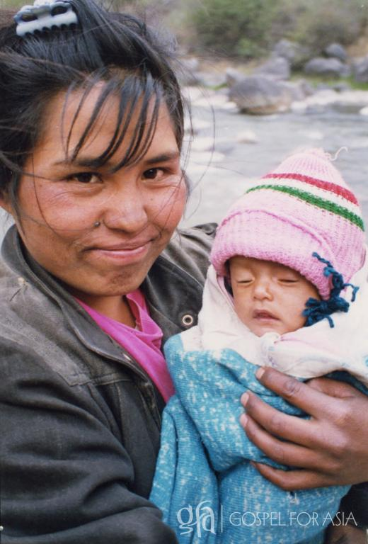 A loving remarkable mom in India poses for the camera with her newborn baby - KP Yohannan - Gospel for Asia