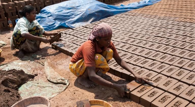 Most people in this woman's village are laborers at a brick factory - KP Yohannan - Gospel for Asia