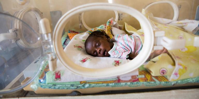 This newborn infant from South Sudan lies in an incubator, suffering from sepsis and jaundice and struggling to survive. His mother died giving birth.