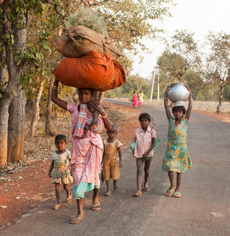 This mother and her five children are returning home from a ten-hour work day in the fields